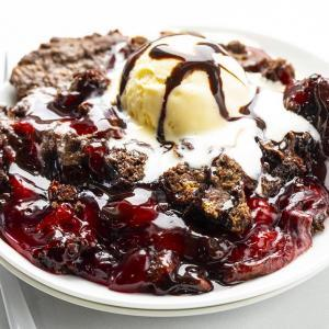 Plate of Chocolate Cherry Dump Cake Recipe with Ice Cream and Two White Forks